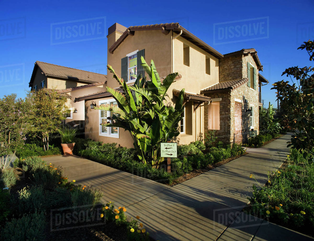 Sidewalk And Landscaping Along Contemporary Tuscan Style Home D145 203 996