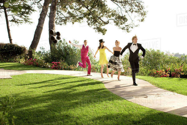 People in elegant clothing running on path in park Royalty-free stock photo