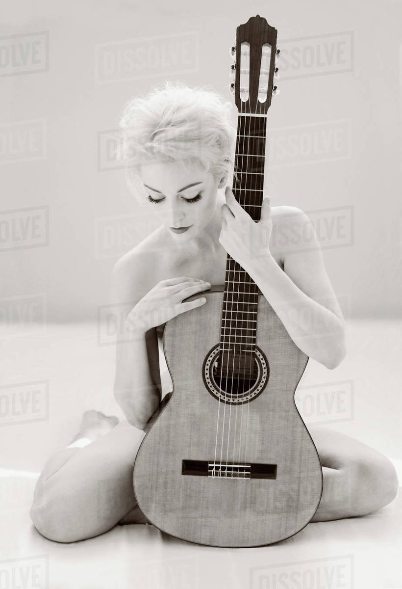 Fill blank... naked blonde girls holding guitar messages Bravo
