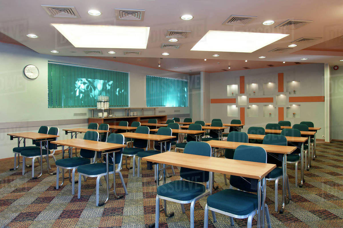 Picture of: Tables And Chairs In Empty Classroom Stock Photo Dissolve
