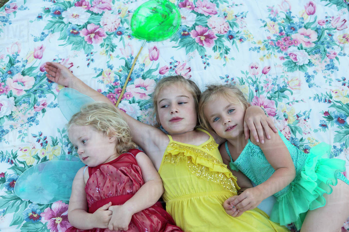 Girls laying on blanket together Royalty-free stock photo