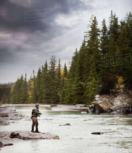 Caucasian man fishing at river Royalty-free stock photo