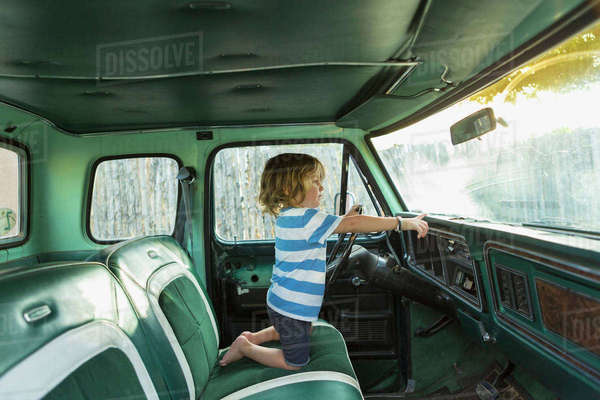 Caucasian boy playing in truck Royalty-free stock photo