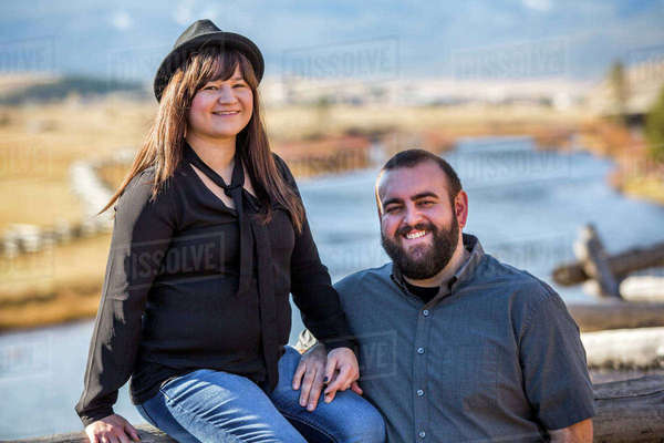 Smiling Caucasian couple posing near river Royalty-free stock photo