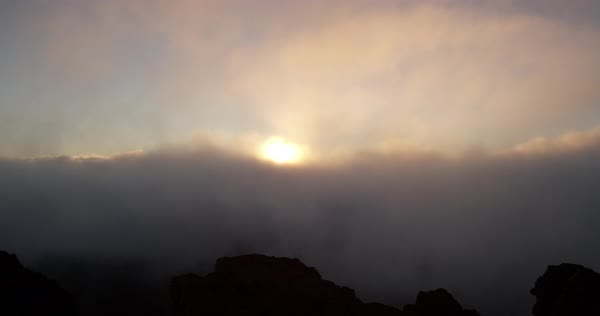 Zoom in past person enjoying sunrise on Haleakala Crater Royalty-free stock video