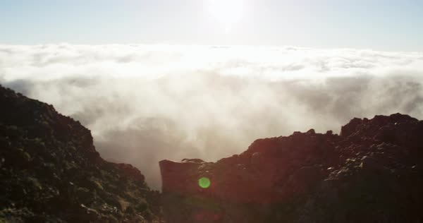 Caucasian woman on top of the Haleakala Crater watching sunrise Royalty-free stock video
