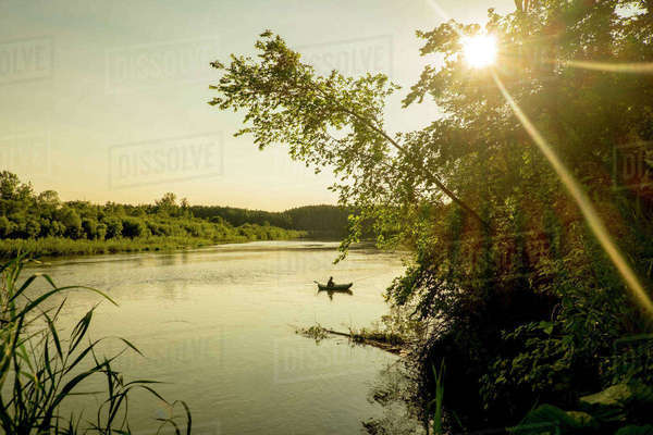 Distant Mari man fishing on lake, Ural, Russia Royalty-free stock photo