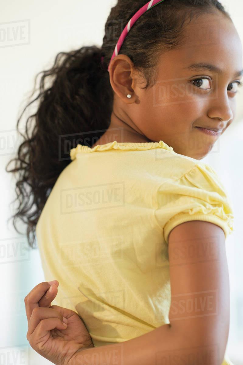 tie her hands behind her back