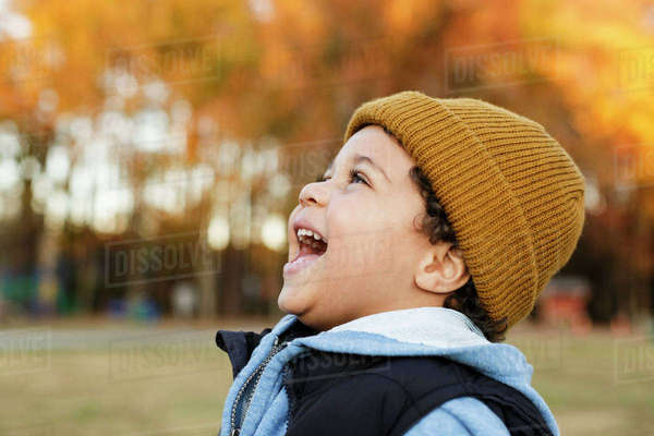 Mixed Race boy laughing in park Royalty-free stock photo