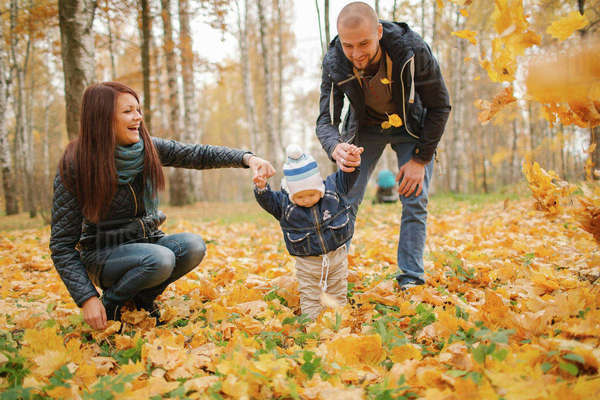 Middle Eastern parents walking with baby son in autumn Royalty-free stock photo