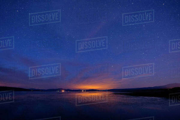 Still rural lake under starry night sky Royalty-free stock photo