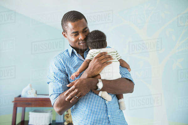 Father cradling baby son Royalty-free stock photo