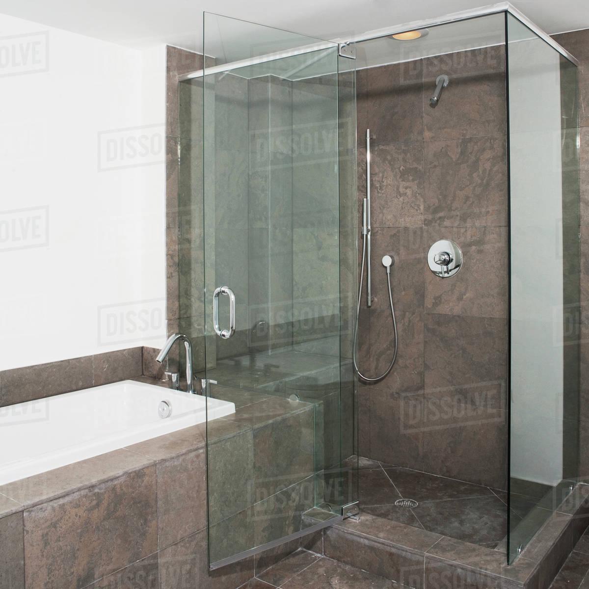 Super Glass Doors Of Shower And Bathtub In Modern Bathroom Stock Photo Download Free Architecture Designs Scobabritishbridgeorg