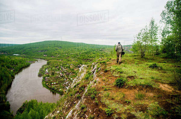Caucasian man hiking in remote landscape Royalty-free stock photo