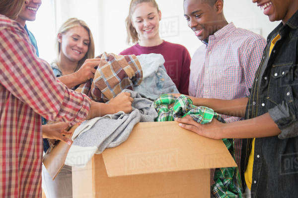 Teenagers donating clothes to charity Royalty-free stock photo
