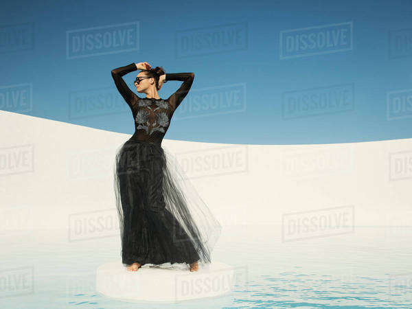 Caucasian woman in evening gown on ice floe Royalty-free stock photo