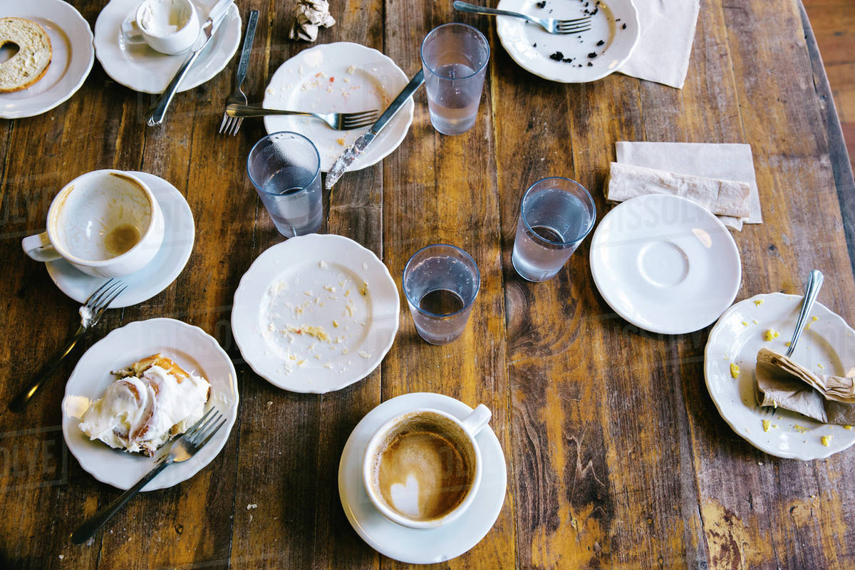 Empty Plates Coffee Cups And Gles On Cafe Table