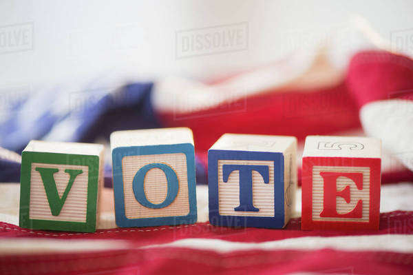 Close up of vote toy blocks on American flag Royalty-free stock photo