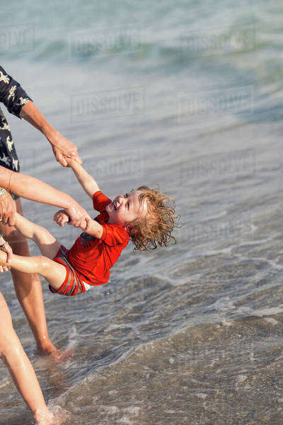 Caucasian family playing on beach Royalty-free stock photo