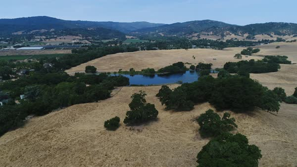 Aerial shot of California landscape with hills and a small lake Royalty-free stock video