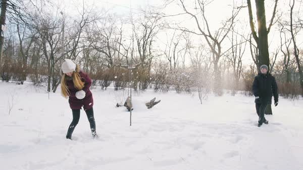 Group of friends having fun snowball fight in snowy park, slow motion Royalty-free stock video