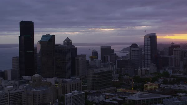 Aerial shot of modern Seattle cityscape at sunset, Washington, United States of America Rights-managed stock video