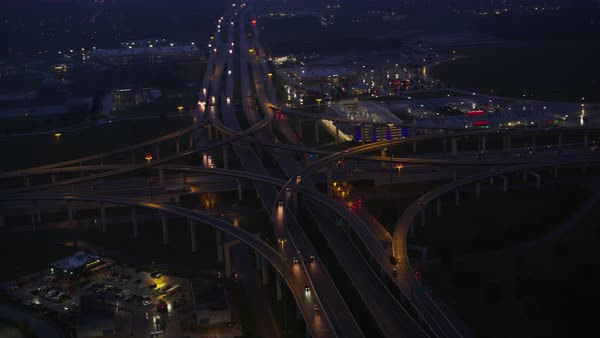 Aerial shot of Houston Texas highway interchange with cityscape at night, United States of America Rights-managed stock video