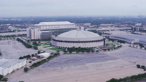 Aerial shot of Reliant Stadium and Astrodome, cityscape in background, Houston, Texas, United States of America Rights-managed stock video