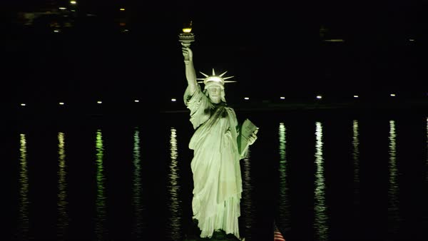 Aerial shot of illuminated Statue of Liberty Rights-managed stock video