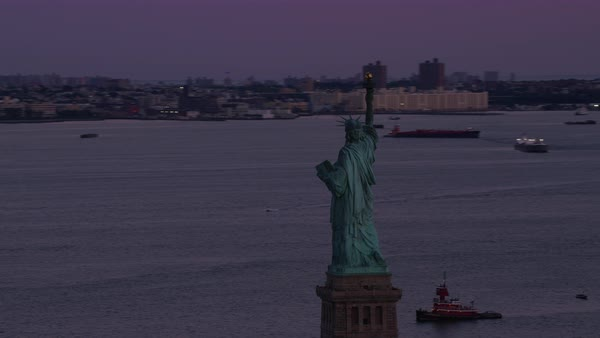 Aerial shot of Statue of Liberty at dusk Rights-managed stock video
