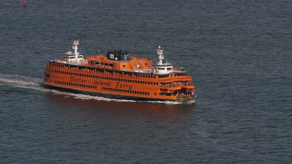 Aerial shot of a moving Staten Island Ferry boat Rights-managed stock video