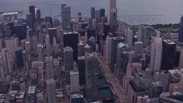 Aerial shot of skyscrapers along Chicago River Rights-managed stock video