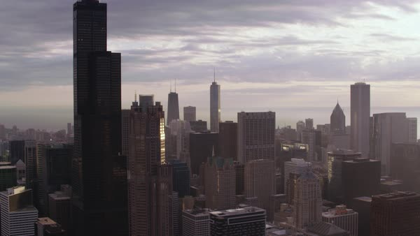 Aerial shot of downtown Chicago cityscape. Willis Tower is prominent in the skyline Rights-managed stock video