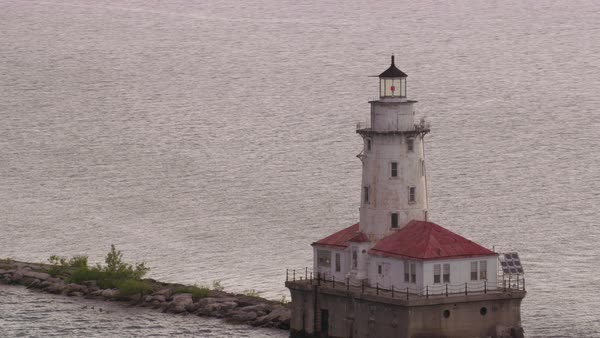 Aerial shot circling the Chicago Harbor Lighthouse Rights-managed stock video