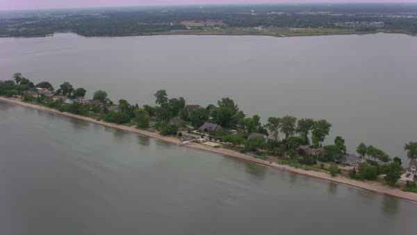 Aerial shot of houses on the Cedar Point peninsula in Lake Erie Rights-managed stock video