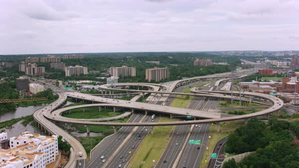 Aerial shot of traffic on a highway interchange Rights-managed stock video