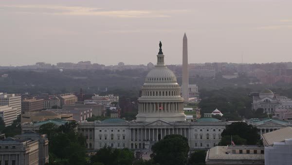 Aerial shot of United States Capitol with Washington Monument in background Rights-managed stock video