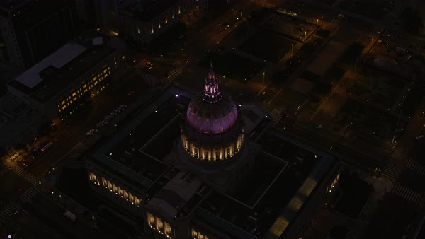 Push-out shot of illuminated San Francisco City Hall Rights-managed stock video