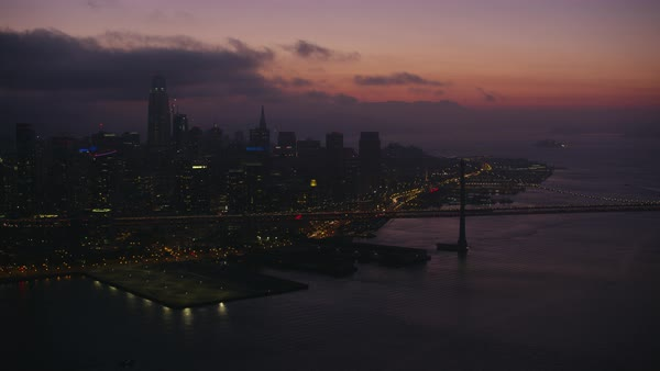 Aerial shot of downtown San Francisco with San Francisco-Oakland Bay Bridge Rights-managed stock video