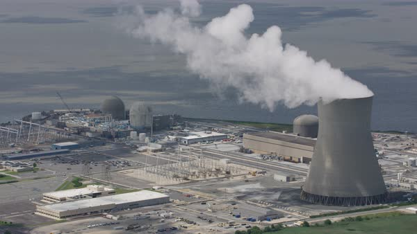 Aerial shot of cooling tower of a nuclear power plant Rights-managed stock video