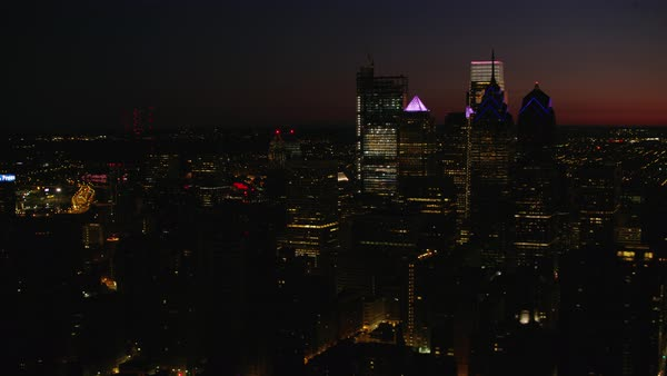 Aerial shot of skyscrapers in downtown Philadelphia at sunrise Rights-managed stock video