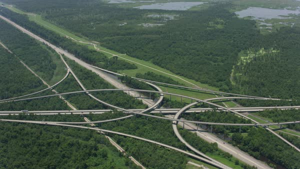 Aerial shot of a highway interchange in Louisiana Rights-managed stock video