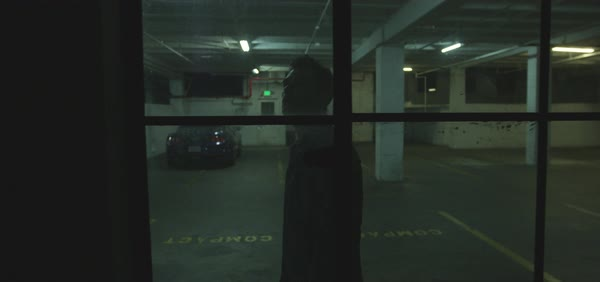 Slow motion shot of a man walking in a parking garage Royalty-free stock video