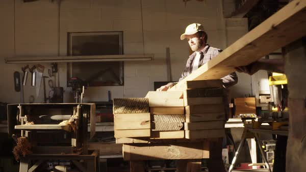 Slow motion shot of two men stacking wooden planks Royalty-free stock video