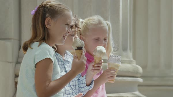 Slow motion shot of three children eating ice cream Royalty-free stock video