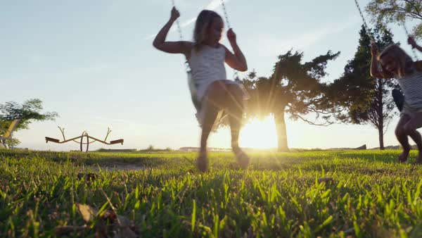 Slow motion shot of two girls swinging on a swing Royalty-free stock video