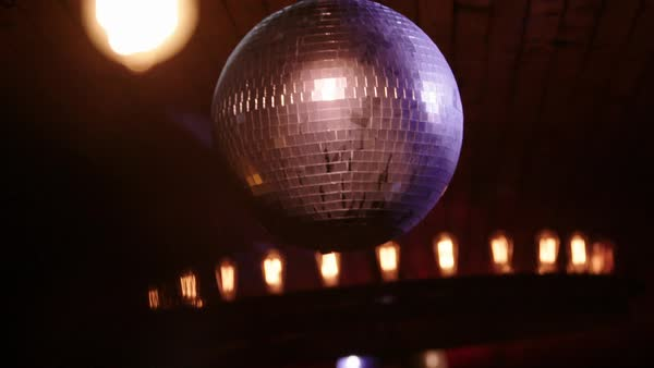 Hand-held shot of a slowly rotating disco ball Royalty-free stock video