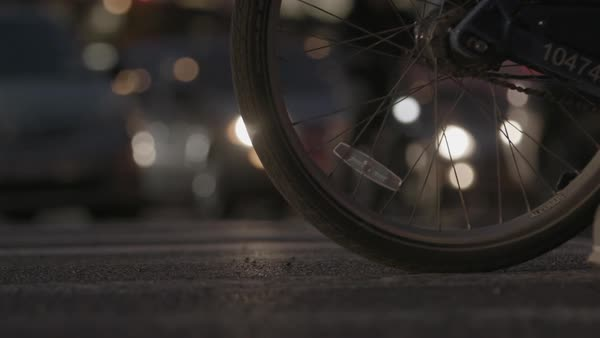 Hand-held shot of a bicycle wheel on a street in New York City Royalty-free stock video