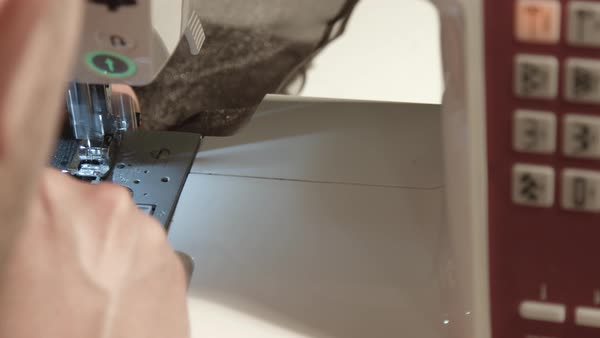 Close-up of person's hands stitching fabric on a sewing machine Royalty-free stock video