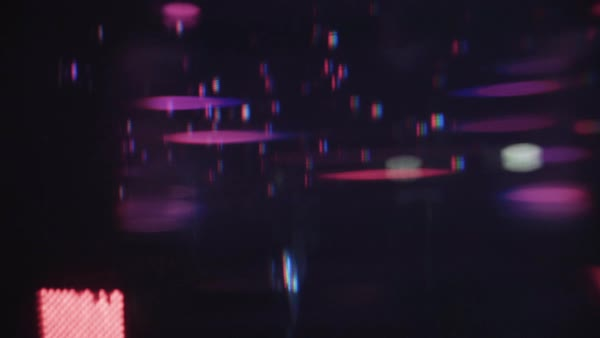 Out of focus shot of purple lights seen through a wet window Royalty-free stock video